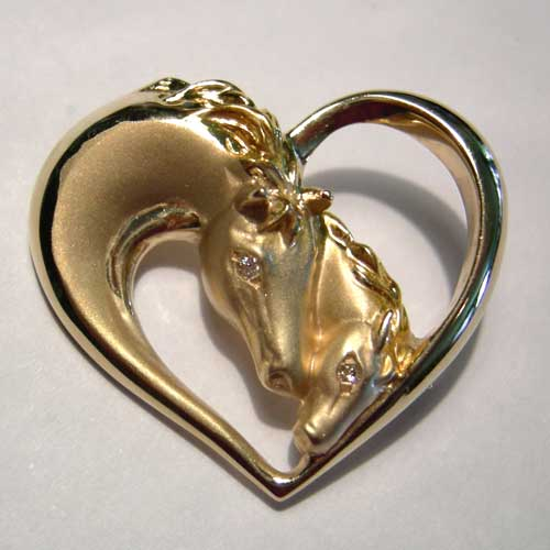 gold mare and foal heads inside heart brooch/pendant
