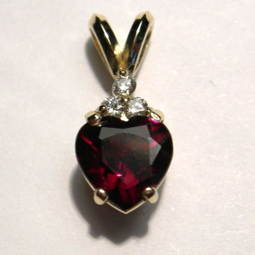 gold heart shaped garnet and diamond pendant
