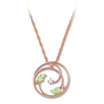 Landstrom's Black Hills Gold Rose Gold circular diamond necklace