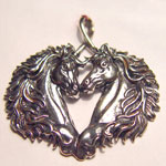 Sterling Silver double horse head pendant