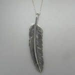 backside of Sterling Silver reversivble Turquoise feather necklace
