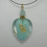 back side of Venetian Glass Clear and Blue Pacific Opal heart on nylon cord