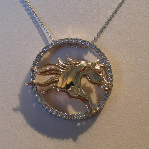 14 karat white and yellow gold diamond horse head necklace