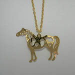 Close up of Pinto Horse pendant of necklace