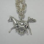 Close up of Arabian mare and foal charm of bracelet