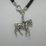 Close of of right side of horse and rider charm