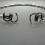Close up of horseshoes on horseshoe bangle bracelet