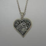 Sterling Silver mare and foal horse heads in heart necklace