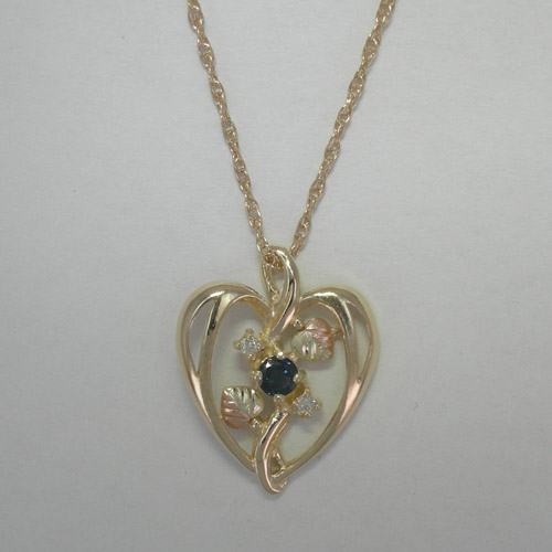 10 karat yellow gold Black Hills Gold heart shaped diamond and Sapphire nec