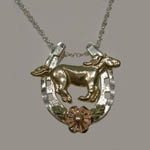 Landstrom's Black Hills Gold Sterling Silver horseshoe and horse necklace
