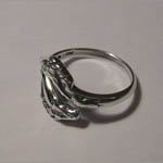 side of Sterling Silver double horsehead ring