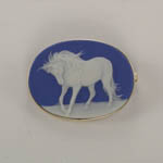 14 karat yellow gold porcelain Andalusian horse brooch