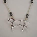 close up of abstract horse necklace