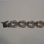 Clasp side of ruby and Cubic Zirconia horseshoe bracelet