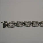 Tongue clasp of sapphire and Cubic Zirconia horseshoe bracelet
