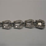 slot side of clasp of sapphire and Cubic Zirconia horseshoe bracelet