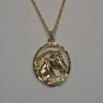 Black Hills Gold horse head in oval necklace
