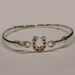 Sterling Silver childs ruby horseshoe bangle bracelet
