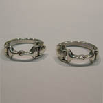side view of snaffle bit hoop earrings