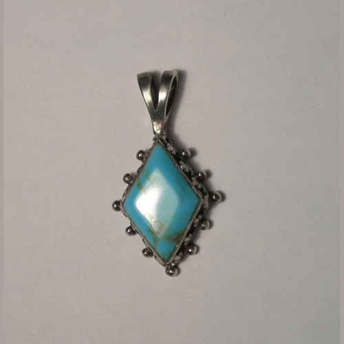 Sterling Silver navette shaped Turquoise pendant