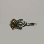 side view of silver and gold flower ring