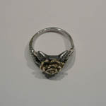 Top view of silver and gold rose ring
