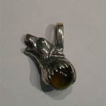 Left side of Sterling Silver Wolf Head Tigers Eye Quartz Pendant
