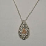 Sterling Silver and rose gold tear drop filigree necklace
