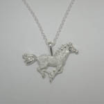 Sterling Silver pave galloping horse necklace