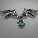Close up of Sterling Silver Blue Topaz horse head pendant