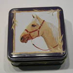Small blue tin with horse head on cover