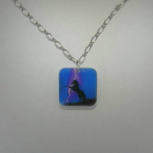 Acrylic rearing black horse in storm necklace.