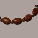 close up of 14 kt.y.g. Goldstone bead necklace